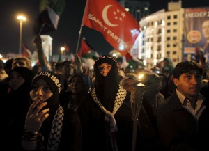 Pro-Palestinian activists attend a rally to mark the first anniversary of the Mavi Marmara Gaza flotilla incident in central Istanbul